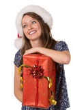 Portrait of happy girl with big Christmas present. Stock Image