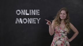 Portrait of happy girl on black background enjoying online money transfers stock footage