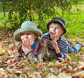 Portrait of happy girl and boy  enjoying in golden autumn season Stock Photo