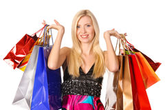 Portrait of happy girl with colorful paper bags Stock Photo