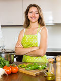 Portrait of happy girl cooking  at  kitchen. Portrait of happy girl cooking with vegetables at  kitchen Stock Photography