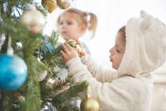 Portrait of happy girl decorating Christmas tree Stock Image
