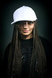 Portrait of happy girl with dreadlocks in cap. Portrait of beautiful happy girl with dreadlocks in cap. Music concept Royalty Free Stock Photography