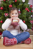 Portrait of happy girl eating turron Royalty Free Stock Photography