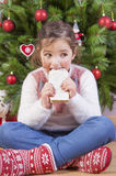 Portrait of happy girl eating turron Royalty Free Stock Images