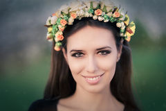 Portrait of a Happy Girl with Floral Wreath Outside Royalty Free Stock Photo