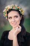 Portrait of a Happy Girl with Floral Wreath Outside Stock Photo