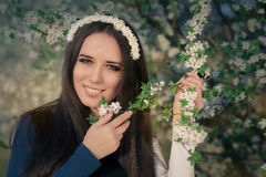 Portrait of a Happy Girl with Floral Wreath Outside Stock Images