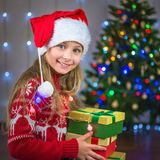 Portrait of a happy girl with a gift on the background of a Christmas tree Stock Photography