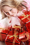 The portrait of the happy girl with gifts.  royalty free stock image