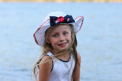 Portrait of a happy girl in a hat on the beach Royalty Free Stock Photos