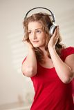 Portrait of happy girl with headphones Royalty Free Stock Photography