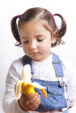 Portrait of happy girl holding a banana Royalty Free Stock Image