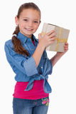 Portrait of a happy girl holding a gift box Stock Image