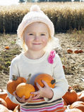 Portrait of a happy girl holding pumpkins in farm Stock Images