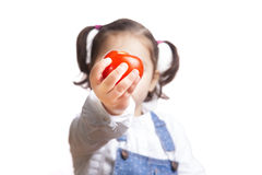 Portrait of happy girl holding a tomato Stock Image