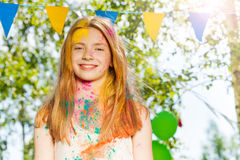 Portrait of happy girl on Holi color festival Stock Photos