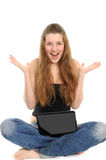 Portrait of happy girl with laptop. Portrait of sitting happy girl with laptop demonstrating a working luck Royalty Free Stock Photos