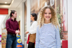 Portrait of happy girl in mall Stock Photo