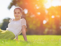 Portrait of happy girl on meadow laying on meadow Stock Photo