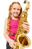 Portrait of happy girl playing alto saxophone Royalty Free Stock Images