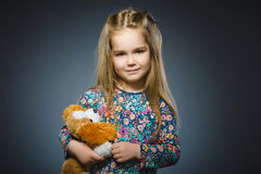 Portrait of happy girl playing with Toy dog isolated on gray Royalty Free Stock Photos