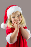 Portrait of a happy girl in a red new year cap Royalty Free Stock Photography
