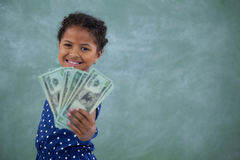Portrait of happy girl showing paper currency Royalty Free Stock Photo