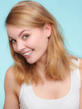 Portrait happy girl smiling woman on blue. Dental. Royalty Free Stock Photo