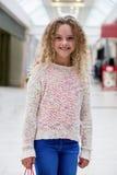 Portrait of happy girl standing in a corridor Stock Photography