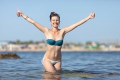 Portrait of happy girl with thumbs up by both hands Royalty Free Stock Image
