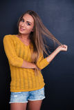 Portrait of a happy girl touching her hair Royalty Free Stock Image