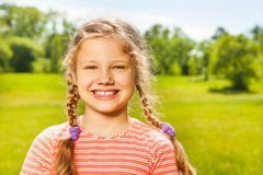 Portrait of happy girl with two braids in summer Stock Photography