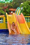 Portrait of a happy girl on water slide royalty free stock images