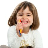 Happy girl with crayons. Stock Image