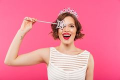 Portrait of a happy girl wearing crown stock images