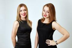 Portrait of happy girlfriends posing in studio Stock Image