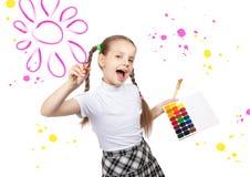 Portrait of happy girls. Schoolgirl draws paints Stock Images