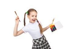 Portrait of happy girls. Schoolgirl draws paints Stock Image