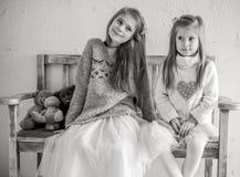 Portrait of Happy Girls Sitting Royalty Free Stock Photography