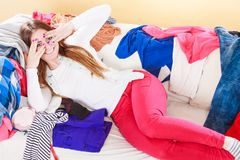 Happy woman lying on clothes covering eyes royalty free stock image