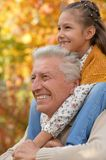 Grandfather and granddaughter in park Royalty Free Stock Photos