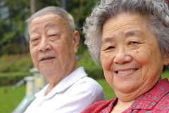 Portrait of happy grandfather and grandmother. In a garden Royalty Free Stock Photography