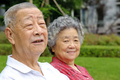 Portrait of happy grandfather and grandmother. In a garden Royalty Free Stock Images