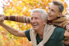 Grandfather and grandson  in park Stock Photo