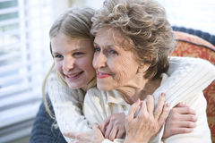Portrait of happy grandmother with grandchild. Hugging Royalty Free Stock Images