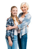 Portrait of happy grandmother and granddaughter embracing Stock Photo