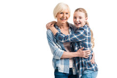 Portrait of happy grandmother and granddaughter embracing Stock Image