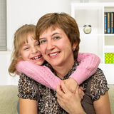 Portrait of happy grandmother and granddaughter. At home Royalty Free Stock Photography