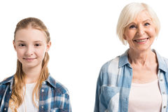 Portrait of happy grandmother and granddaughter looking at camera Royalty Free Stock Images